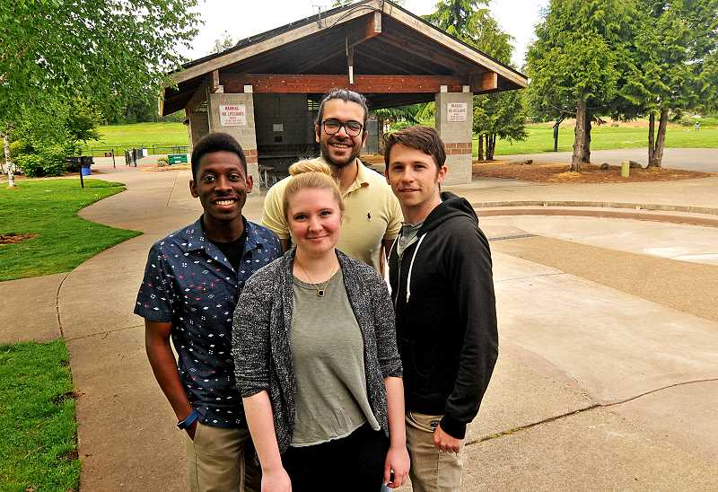 TIDINGS PHOTO: VERN UYETAKE  - From left, OIT students Christopher Crockett, Mariah Wills, Abdulaziz Zee Alkhattab and Austin Tanzer pose in front of one of the existing solar panels at Tanner Creek Park.