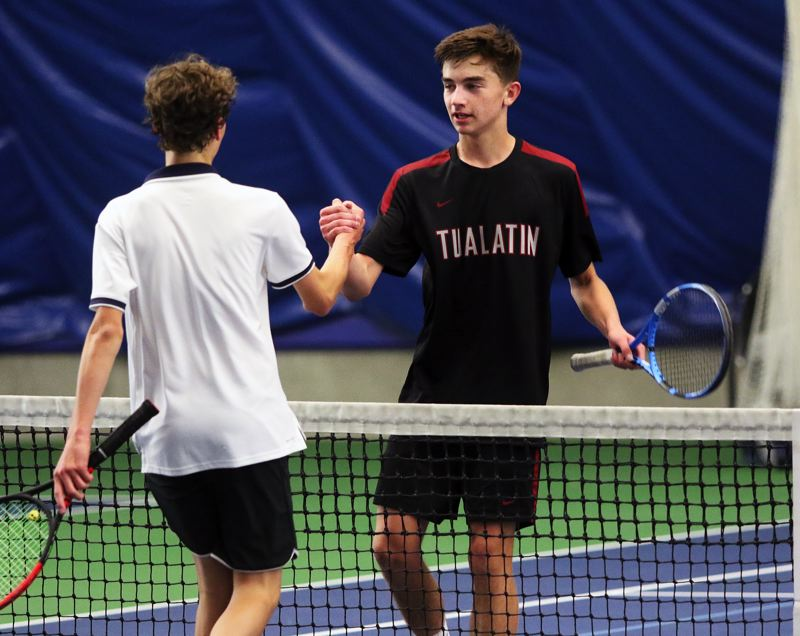 TIMES PHOTO: DAN BROOD - Tualatin's Will Havenar (right) finishes play in the boys singles third-place match at the Three Rivers League district tennis tournament.