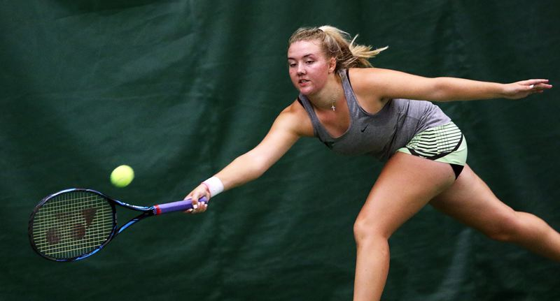 TIMES PHOTO: DAN BROOD - Tigard's Lizzy Stevens hits a shot during the girls singles title match at the Three Rivers League district tennis tournament.