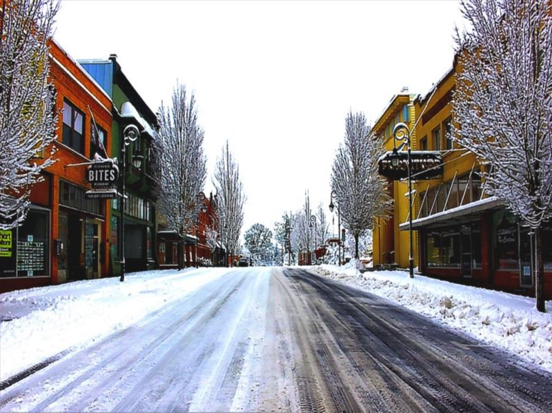 COURTESY PHOTO: DOUG REID - 'Snowy Forest Grove' is a seasonal streetscape of Main Street in historic downtown Forest Grove. The photo was chosen as the winner of the Historic Photo Contest among adult submissions.