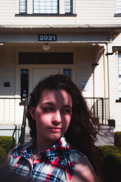 COURTESY PHOTO: ERIK RAMIREZ - 'Shadows' is a portrait of a young woman in front of Old College Hall in Forest Grove, with part of her in light and part of her in shade. The photo was chosen as the winner of the Historic Photo Contest among youth submissions.