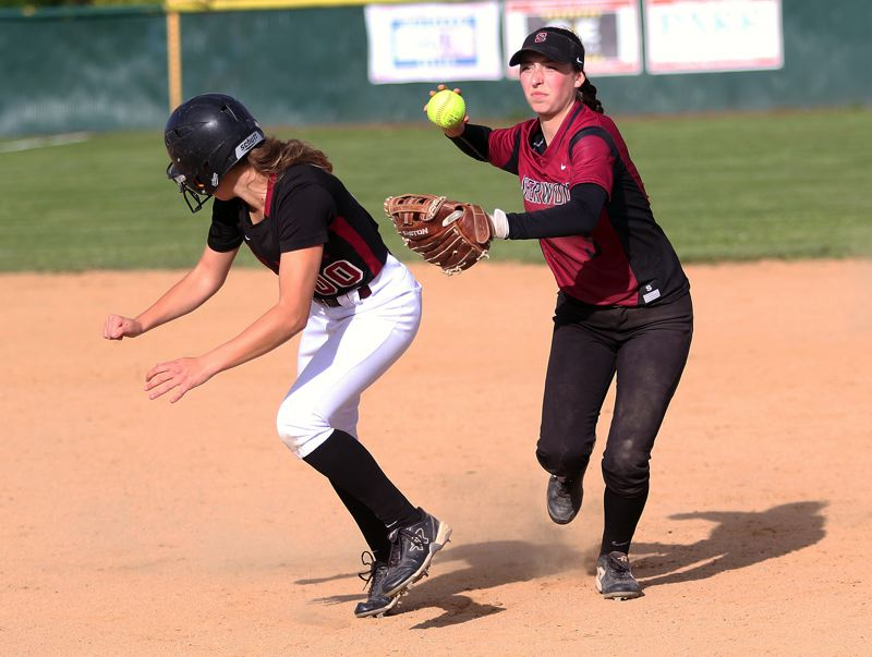 TIMES PHOTO: DAN BROOD - Sherwood sophomore second baseman Emily Knott (right) looks to make a thow to first after tagging out Tualatin senior Kayla Laird.