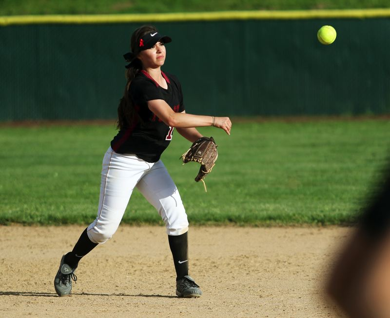 TIMES PHOTO: DAN BROOD - Tualatin junior second baseman Andrea Gomez fires a throw to first base during the win over Sherwood.