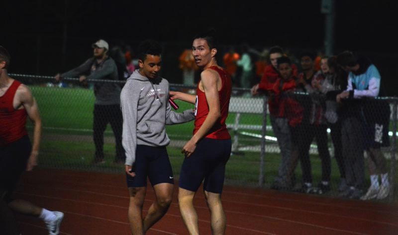 TIMES PHOTO: MATT SINGLEDECKER - Westview senior Keizo Morgan and his 4x400 relay celebrate their first place win over Jesuit at the Metro district meet.
