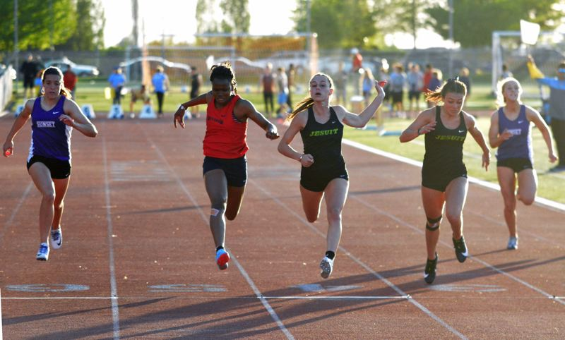 TIMES PHOTO: MATT SINGLEDECKER - Jesuit senior Lena Colson won hte 100, 200 and ran on two triumphant Crusader relays at the Metro district meet on Friday.