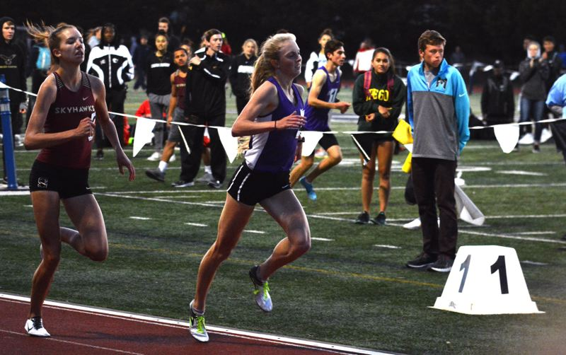 TIMES PHOTO: MATT SINGLEDECKER - Sunset star runner Kelly Makin won the 800 and 1,500 at the Metro district meet on Friday.