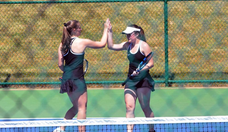 TIMES PHOTO: MATT SINGLEDECKER - Sydnie and Cassidy Binder won the Metro League doubles championship for Beaverton on Saturday.