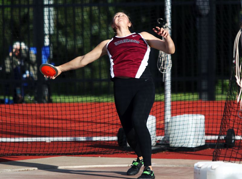 TIMES PHOTO: DAN BROOD - Sherwood senior Shelby Moran is about ready to led the discus fly during competition at the Three Rivers League district meet.