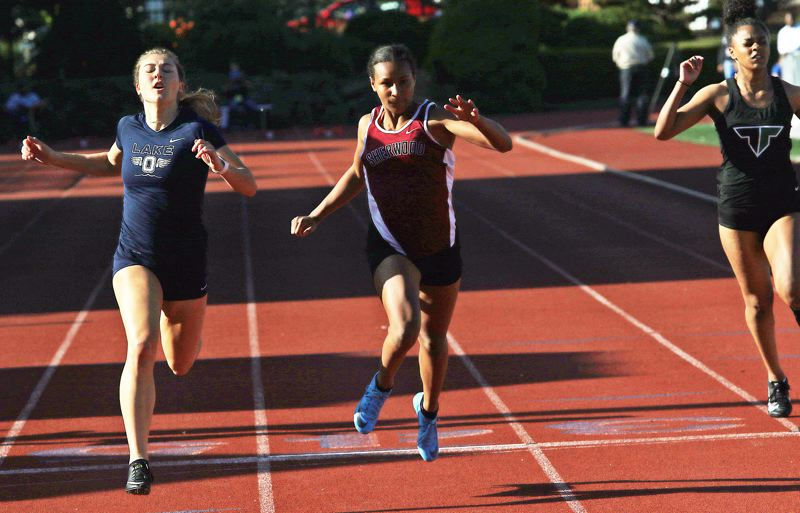 TIMES PHOTO: DAN BROOD - Sherwood freshman Nora Hagan sprinted to second place in the 100-meter dash at the TRL district meet.