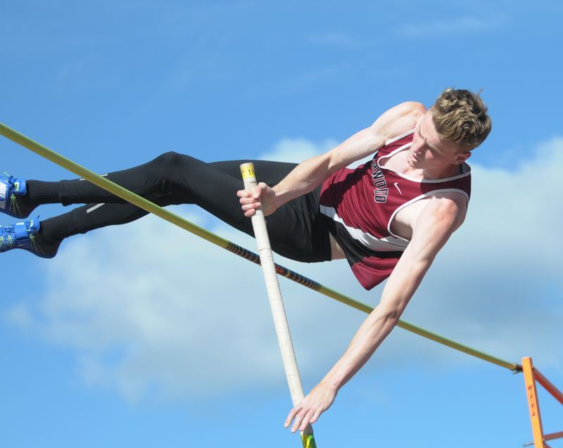 PAMPLIN MEDIA GROUP: SETH GORDON - Sherwood's Peyton Churilla looks to get over the bar in the pole vault competition at the three Rivers League district meet.