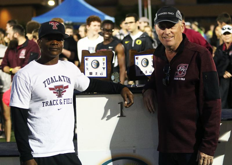 TIMES PHOTO: DAN BROOD - Sherwood's Terrel Smith (right) was named the Three Rivers League track and field boys coach of the year.