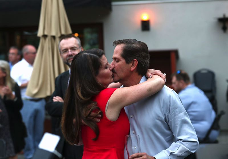 TIMES PHOTO: JAIME VALDEZ - Rep. Knute Buehler celebrates Tuesday with his wife, Dr. Patricia Buehler.