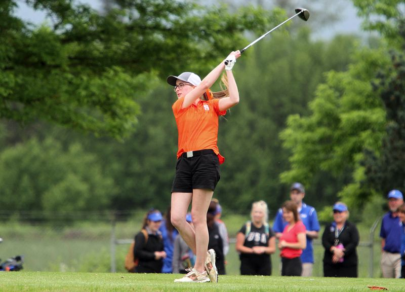 SPOTLIGHT PHOTO: MILES VANCE - Scappoose senior Kaitlyn Bakkensen tees off at the start of Tuesday's second round of the Class 4A/3A/2A/1A state golf tournament at Quail Valley Golf Course in Banks.