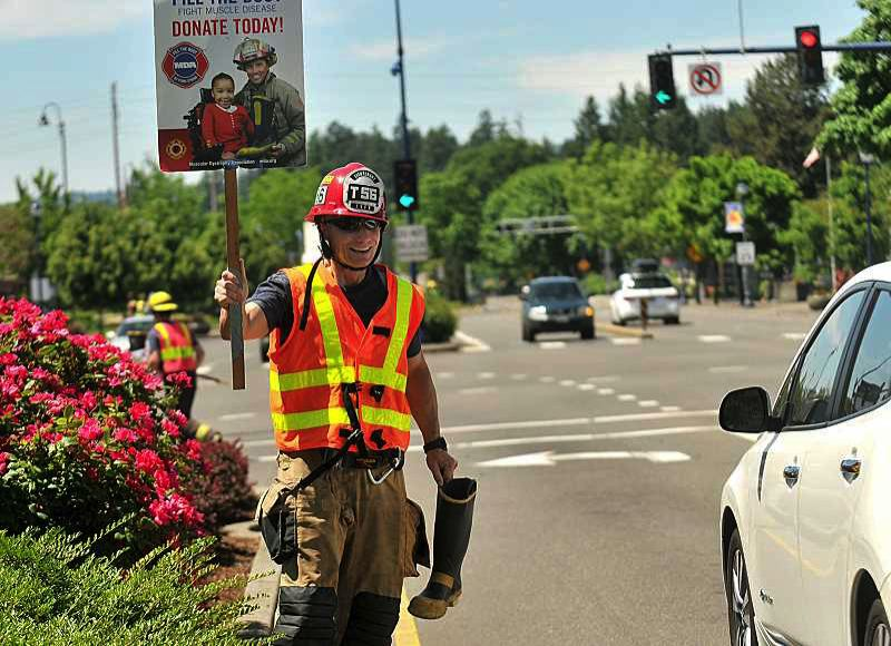 FILE PHOTO - Firefighters 'filling the boot' to raise money for the fight against muscular dystrophy.