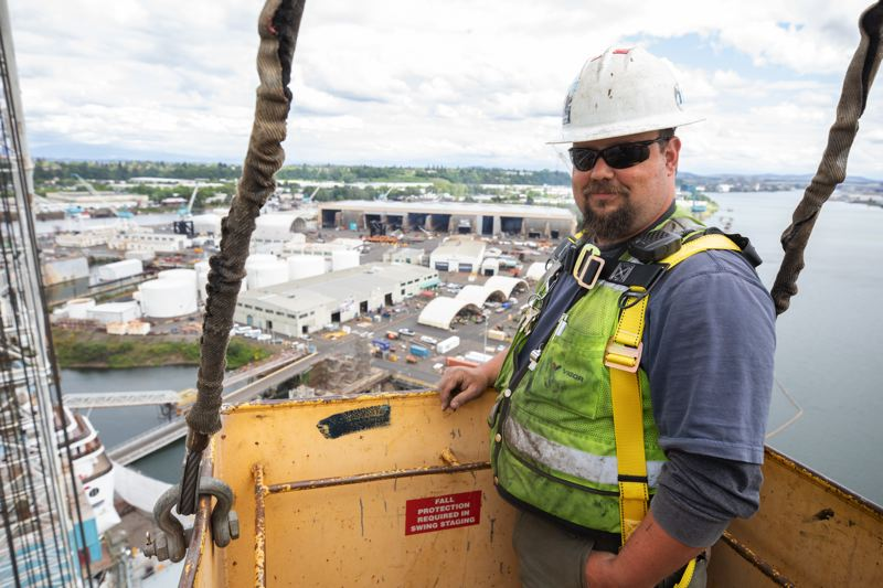 PAMPLIN MEDIA GROUP: JONATHAN HOUSE - Rigger David Webster controls the cage that enables a drone's-eye view of the Legend in dry dock.