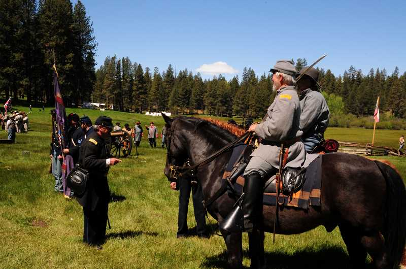 BILL VOLLMER - North and South military men on the field at last year's Civil War re-enactment near Camp Sherman prepare for battle. The fifth annual event, presented by the Northwest Civil War Council, takes place Saturday and Sunday, May 19 and 20.
