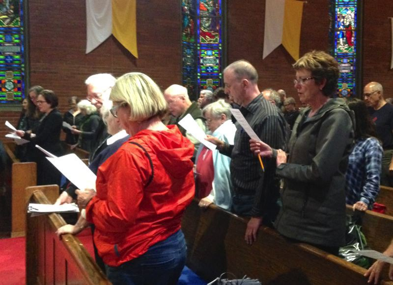 CLAIRE WITHYCOMBE/CAPITAL BUREAU - Volunteers for a citizen's initiative petition campaign to restrict assault-style weapons in Oregon sing at Augustana Lutheran Church in Portland before training on gathering signatures is support of the petition.