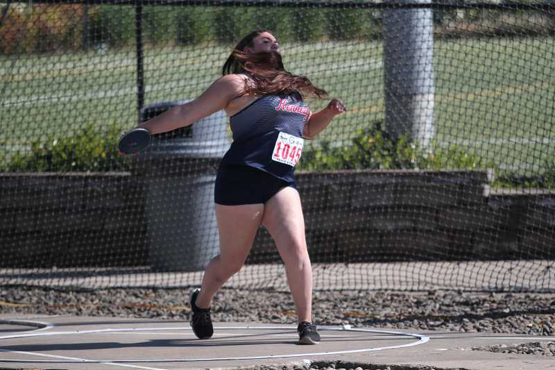 PHIL HAWKINS - Kennedy junior Lilly English upped her personal-best mark in the discus to 105-11 to finish fifth in the competition at the 2A Track and Field State Championships.