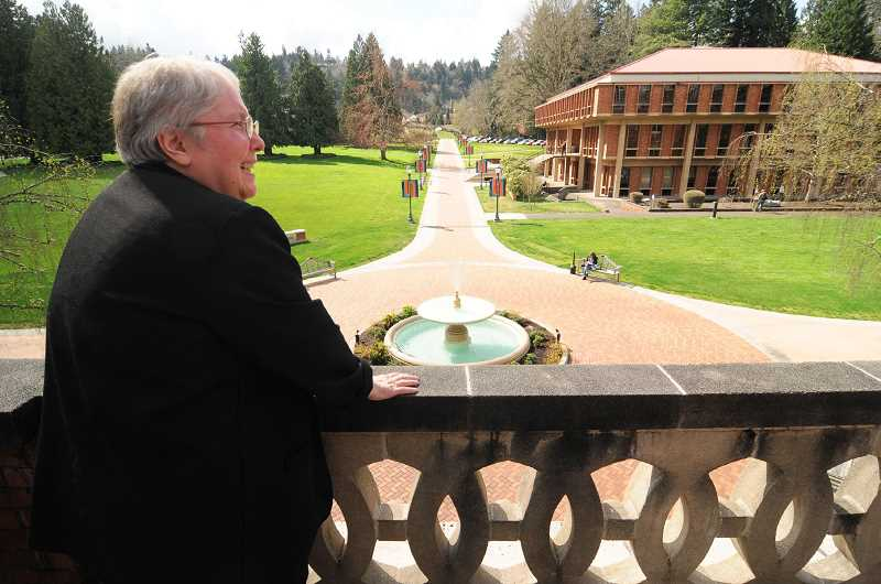 REVIEW PHOTO: VERN UYETAKE - Sister Carole Strawn, an historian and former longtime employee at Marylhurst University, looks out over the school's sprawling campus. Marylhurst is a heritage site of the Sisters of the Holy Names. Following the closure of the university, the campus will be returned to the Sisters, the university said.