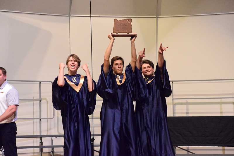 COURTESY PHOTO - Canby choir members enjoy their third place state victory at George Fox University on May 5.