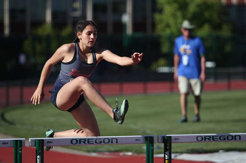 PHIL HAWKINS - Kennedy junior Caitlyn Perez finished third in her heat of the 300 hurdles preliminary race in 53.30 to qualify for the finals at the 2A Track and Field State Championships.