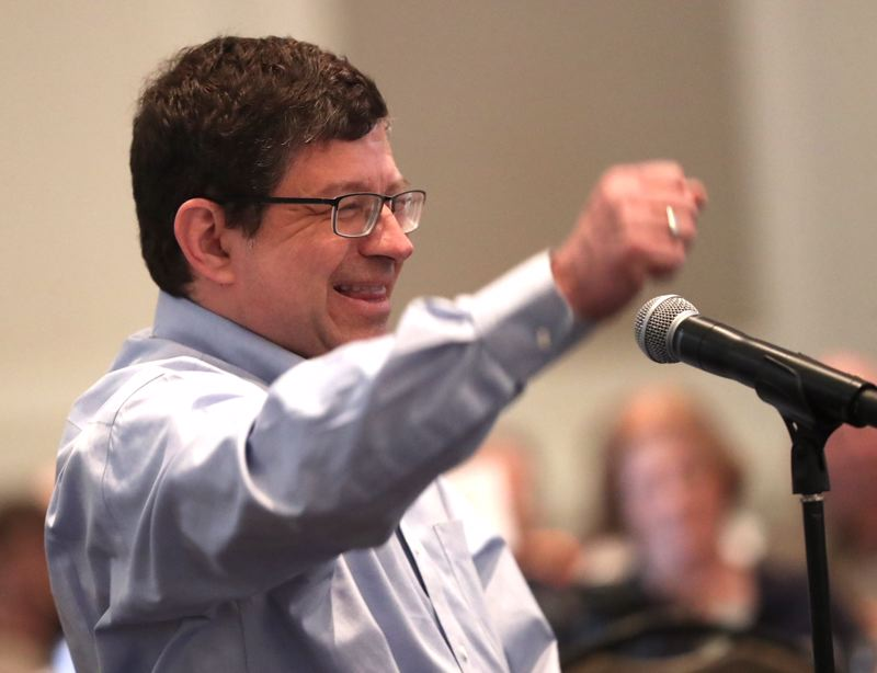 JAIME VALDEZ/PORTLAND TRIBUNE - Former Portland Commissioner Steve Novick celebrates after Gov. Kate Brown tells him during a Portland City Club Friday Forum Q&A that she plans to work with state lawmakers to address Oregon's inequitable property tax system.