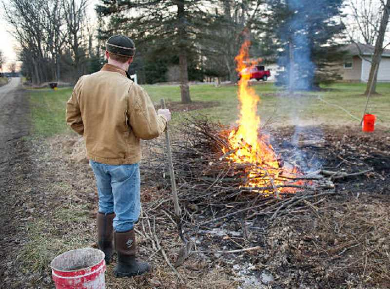 SUBMITTED PHOTO - When burning yard debris, keep the pile small, have water on hand and never leave the fire unattended.