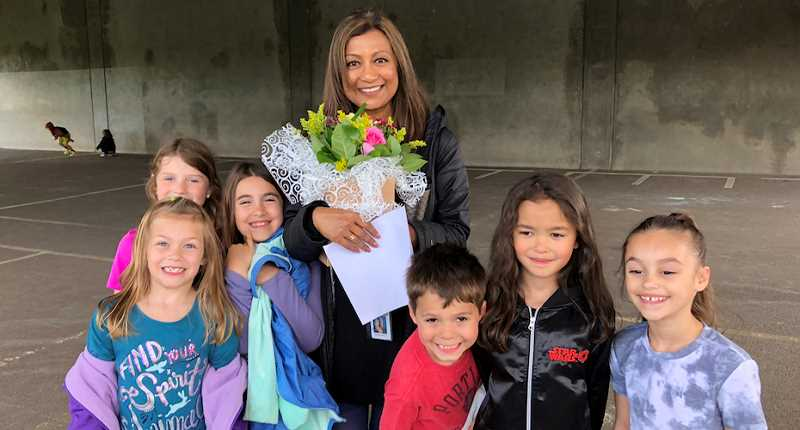 COURTESY OF TIGARD-TUALATIN SCHOOL DISTRICT - Naheed Brown, surrounded by her student supporters, was surprised with an announcement Thursday that she had been named an Oregon Regional Teacher of the Year.