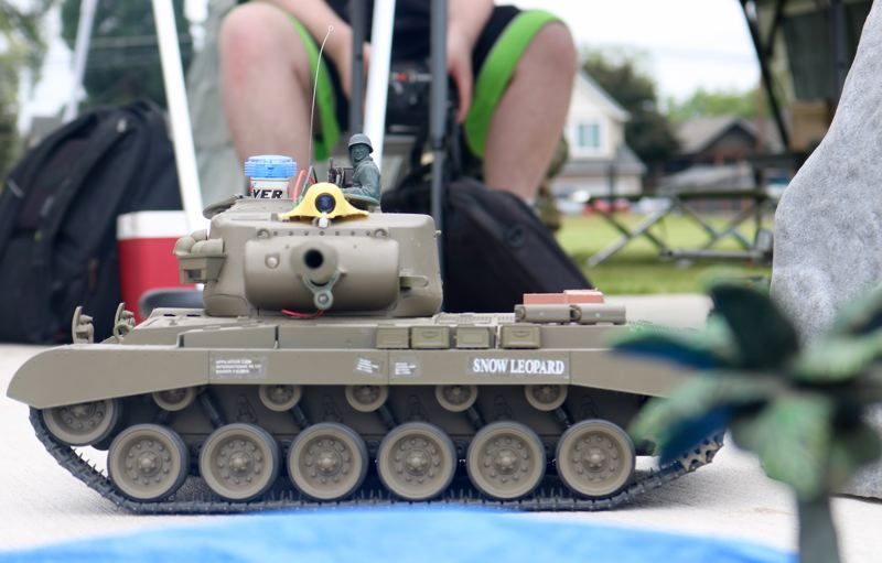REVIEW PHOTO: ZANE SPARLING - A young man pilots a Snow Leopard remote-control tank during Living History Day on Saturday, May 19 in Clackamas.