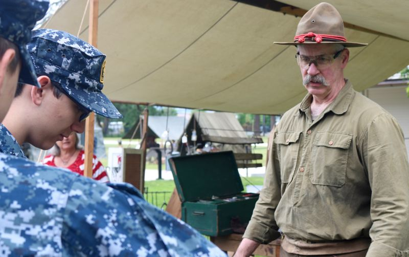REVIEW PHOTO: ZANE SPARLING - A man demonstrates blacksmithing techniques during Living History Day on Saturday, May 19 at Camp Withycombe in Clackamas.
