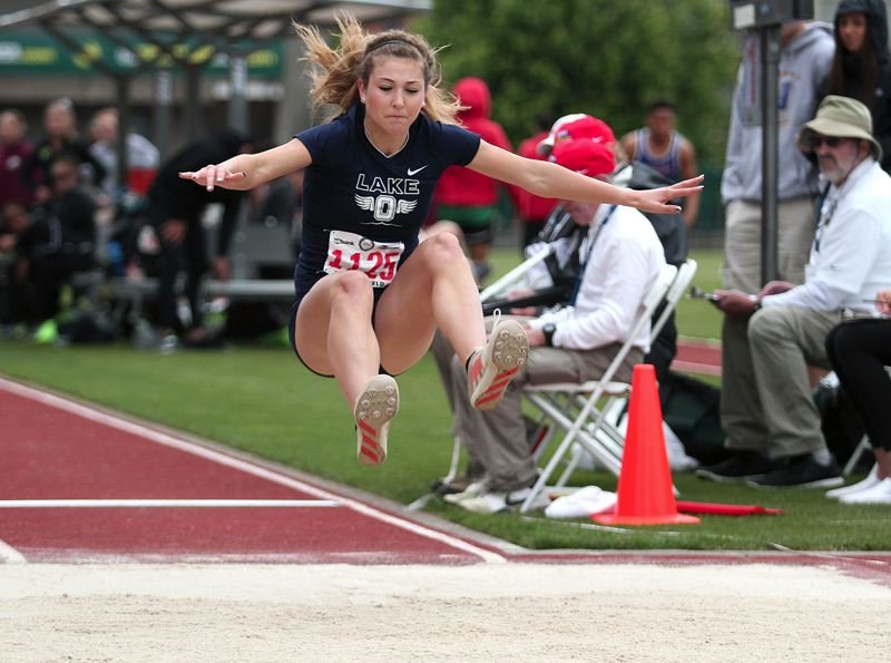 PAMPLIN MEDIA GROUP PHOTO: PHIL HAWKINS - Lake Oswego's Maddie DeBorde soars to victory in the Class 6A state long jump on Friday at Hayward Field in Eugene.