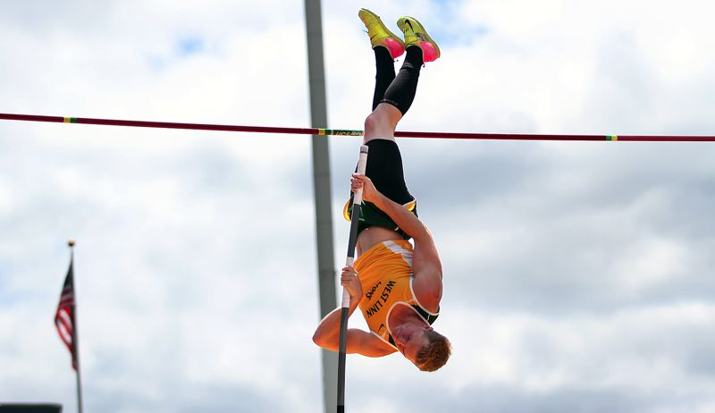 PAMPLIN MEDIA GROUP PHOTO: PHIL HAWKINS - West Linn senior Justin Gould soars to his first Class 6A championship in the pole vault on Friday at Hayward Field in Eugene.