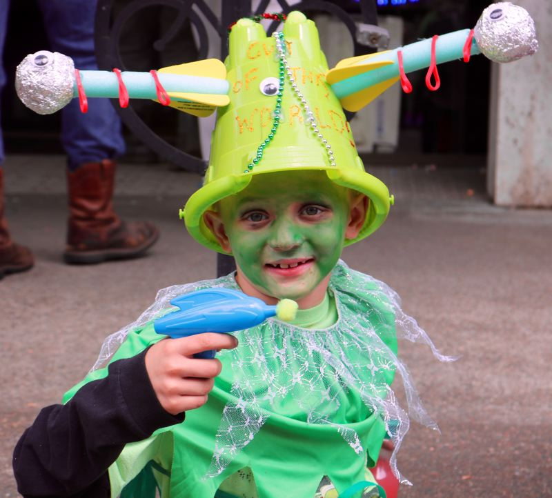 TRIBUNE PHOTO: ZANE SPARLING - Logan, a second-grader from Scappoose, shows off his ray gun during the McMenamins' UFO Festival on Saturday, May 20, in McMinnville.