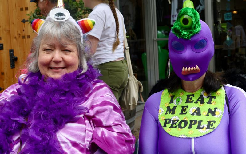 TRIBUNE PHOTO: ZANE SPARLING - Sisters Maggie King (left) and Sylvia Worrix are dressed as Purple People Eaters.