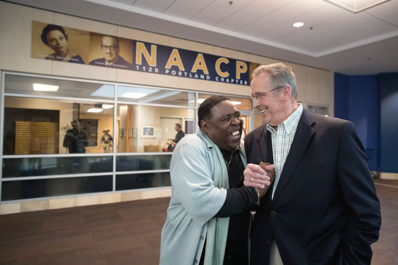 PAMPLIN MEDIA GROUP: JAIME VALDEZ - E.D. Mondaine, the president of the Portland NAACP, and Lloyd Center Mall Manager Bob Dye, in front of the new office of the NAACP next to Marshall's. Both men hope it will help improve race relations in the city.