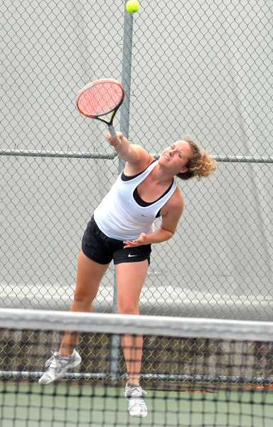 SPOKESMAN PHOTO: TANNER RUSS - Kara Rule serves the ball to her opponent in the first round of the state tournament. Kara and Camille Rule were eliminated in the first round, but won their following match in the consolation bracket.