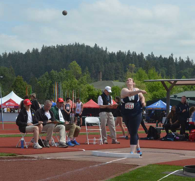 SPOKESMAN PHOTO: TANNER RUSS - Senior Maggie Woginrich took first place in the shot put event with a throw of 40 feet 4 inches.