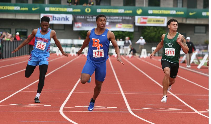 PAMPLIN MEDIA GROUP: JIM BESEDA - Micah Williams (center) of Benson Tech wins the state championship in the 100 meters.