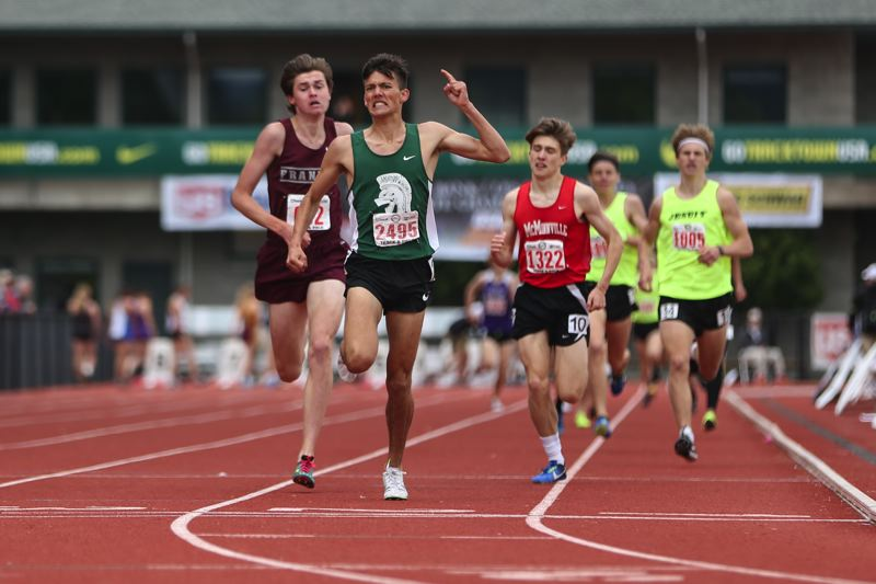 TRIBUNE PHOTO: DAVID BLAIR - Alex Slenning of Wilson edges Franklin's Will Eaton in a 1-2 Portland Interscholastic League finish to the Class 6A boys 1,500-meter final Saturday at Hayward Field.