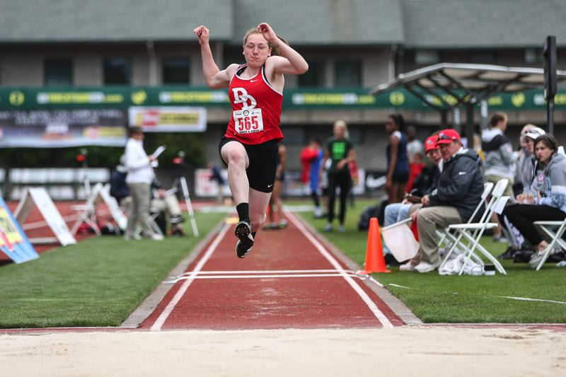 TRIBUNE PHOTO: DAVID BLAIR - David Douglas High's Savannah Proske competes in the triple jump. She placed fifth, then won the 6A high jump crown.