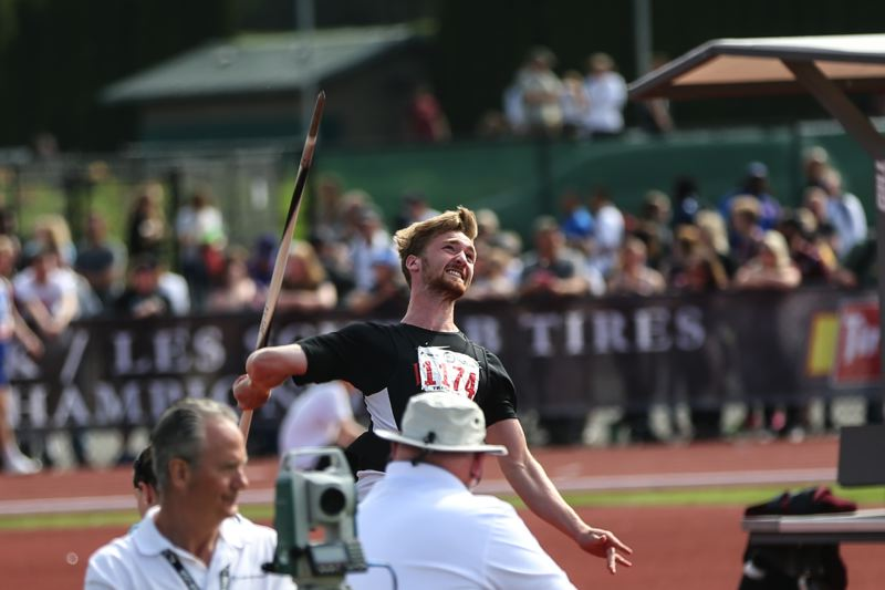 PAMPLIN MEDIA GROUP: DAVID BLAIR - Sawyer Christopher of Lincoln lets loose with a javelin throw as he successfully defends his state championship.