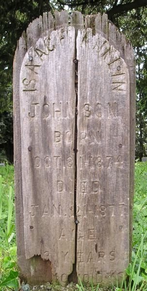 PHOTO BY JUDY GRIFFIN - This wooden marker shows the site where Isaac Franklin Johnson, 3, was buried at the Clackamas Pioneer Cemetery in 1877.