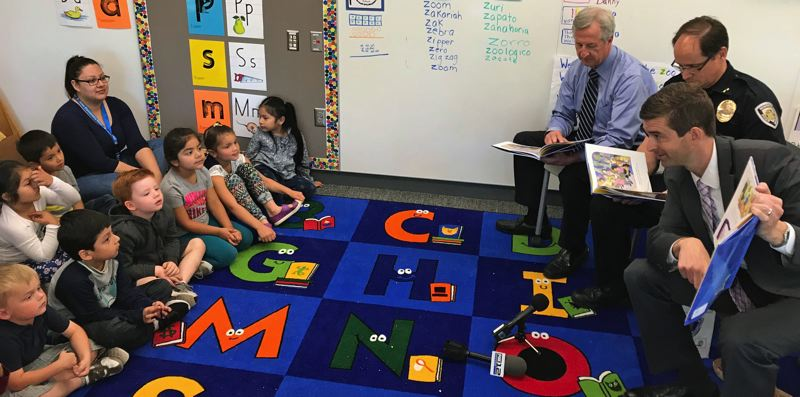 TIMES PHOTO: DANA HAYNES - Reading to pre-kindergartners in Beaverton are, from left, District Attorney Bob Hermann, Beaverton Police Chief Jim Monger, and DA-elect Kevin Barton.