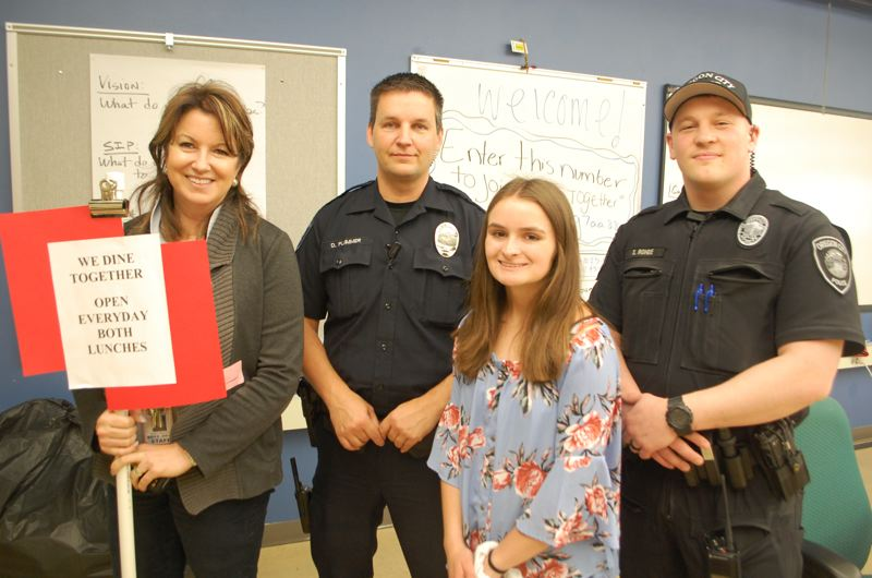 PHOTO BY: RAYMOND RENDLEMAN - OCHS Vice Principal Kathy Johnson, and OCPD Officers Dave Plummer and Spencer Rohde, help Sophomore Class President Shaylee Cooper welcome kids to the new club.