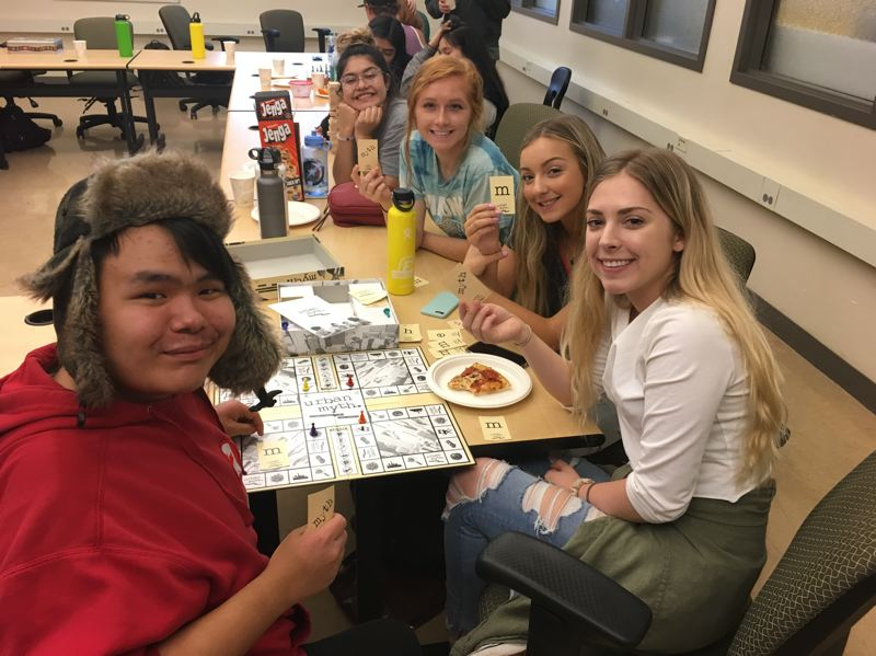 SUBMITTED PHOTO - Playing board games at We Dine Together are, from left, Jeremiah Johnson, Maddie Dennis, Jordyn Thomas, Kylei Halbakken and Maria Jose.