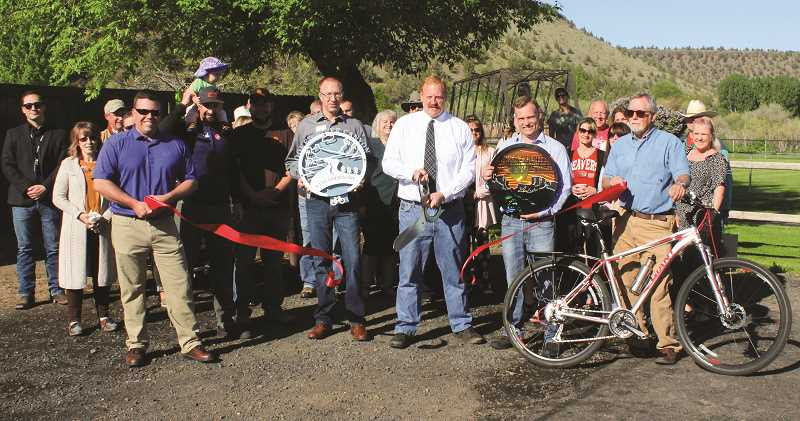 HOLLY SCHOLZ - Scenic Bikeway Steering Committee members from left to right, Travis Garner, James Good, Casey Kaiser, Seth Crawford, Duane Garner and Greg Currie cut the ribbon Friday morning at Rimrock Park.