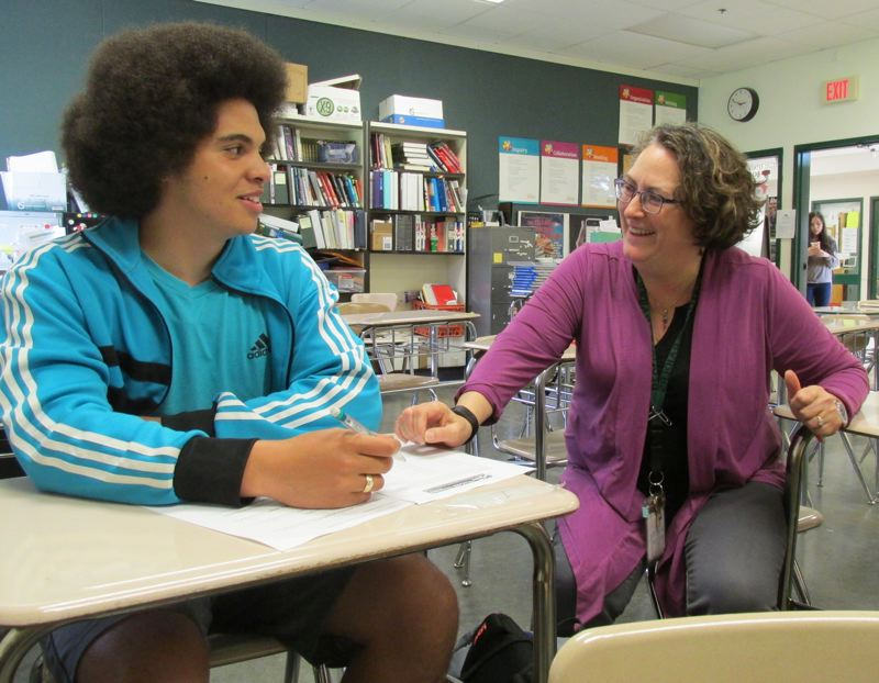 OUTLOOK PHOTO: TERESA CARSON - Teacher Teresa Osborne works with AP government student and Reynolds High School senior Dante Young after school.