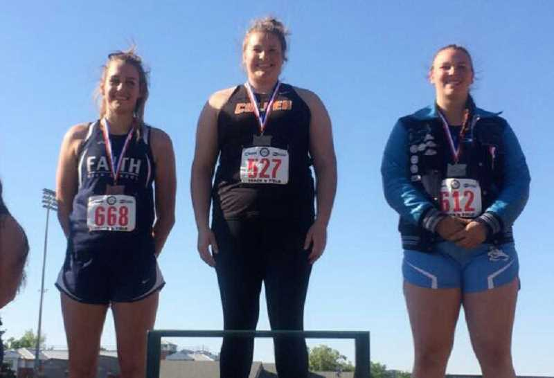 SUBMITTED PHOTO - Catylynn Duff poses on the podium, winning both the shot put and discus and state.