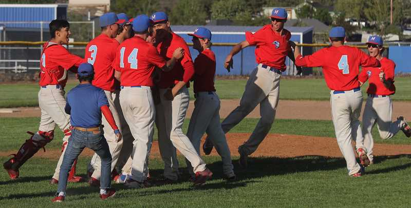 STEELE HAUGEN - The Madras baseball team celebrates their 13-10 home play-in victory over Mazama.
