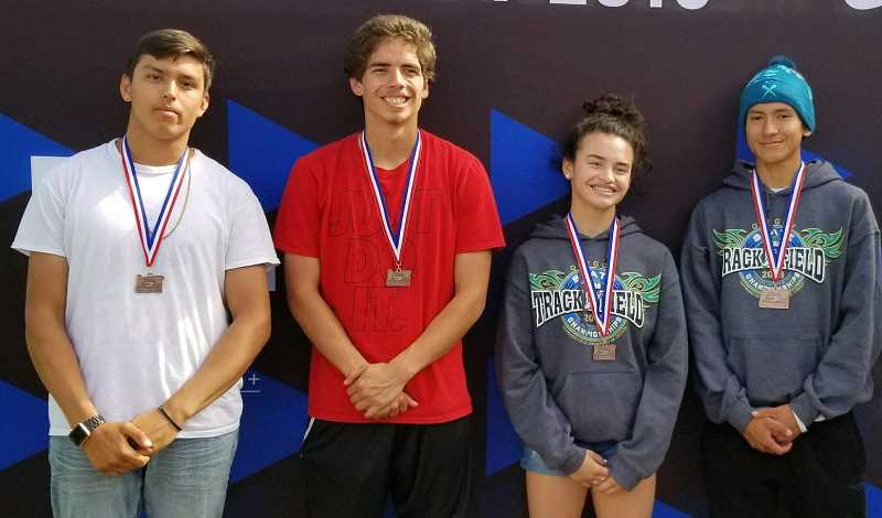 SUBMITTED PHOTO - Chad Thurby, Dalton Waldow, Olivia Symons and Tyler Anderson pose with their medals they earned at state.
